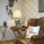 Hydes leather chair with table lamp & Humming bird cushion